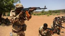 Malian soldiers point their AK-47 rifles during a training session given by a French army officer in Koulikoro May 7, 2013. (STRINGER/REUTERS)