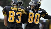 Hamilton Tiger-Cats wide receiver Andy Fantuz (L) celebrates his touchdown with Chris Williams during the first half of their CFL football game against the Toronto Argonauts in Hamilton July 14, 2012. (MIKE CASSESE/REUTERS)
