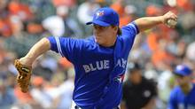 Toronto Blue Jays relief pitcher Aaron Loup works against the Baltimore Orioles during the seventh inning of their American League baseball game in Baltimore, Maryland April 24, 2013. (DOUG KAPUSTIN/REUTERS)