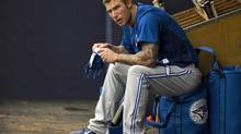 Toronto Blue Jays designated hitter Brett Lawrie sits in the dugout during a MLB spring training game against the New York Yankees at George M. Steinbrenner Field in Tampa, Florida, February 24, 2013. (STEVE NESIUS/REUTERS)