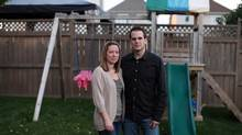 Melanie Audette and her husband, Alain, stand in their eastern Ottawa backyard on Oct. 1, 2013. They lost one child due to an accident at an unlicensed facility three years ago. (DAVE CHAN FOR THE GLOBE AND MAIL)