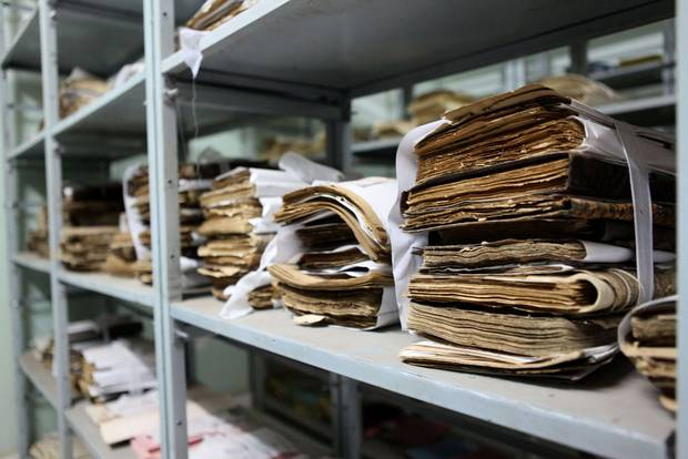 Manuscripts sit on Jan. 28, 2015, on shelves at the Ahmed Baba Institute in Bamako, Mali. Hundreds of thousands of priceless parchments sit on metal shelves in Mali's capital as archivists painstakingly classify and digitize them.