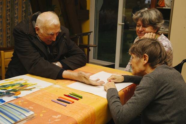 Jean Vanier visits the residents in one of the L'Arche homes in Trosly, France.