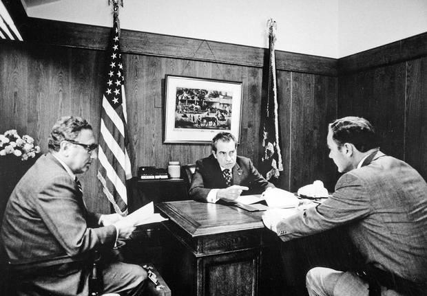 1972: Richard Nixon discusses the Vietnam War at Camp David with National Security Advisor Henry Kissinger, left, and major-general Alexander Haig Jr.