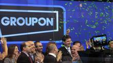 Employees and guests of Groupon ring the opening bell in celebration of the company's IPO at the Nasdaq Market in New York November 4, 2011. (BRENDAN MCDERMID/REUTERS)
