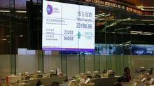 The closing blue chip Hang Seng index is displayed inside the trading hall of the Hong Kong Stock Exchange (Bobby Yip/Reuters)