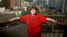 Lori-Ann Ellis wears a memorial t-shirt remembering her slain sister-in-law Cara Ellis as she stands on the balcony of her Vancouver hotel room Oct. 14, 2011. (Jeff Vinnick for The Globe and Mail)