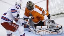 Philadelphia Flyers' Brian Boucher, right, blocks a shot by New York Rangers' Olli Jokinen, of Finland, during a shoot out in their NHL hockey game, Sunday, April 11, 2010, in Philadelphia. Philadelphia won 2-1. (AP Photo/Matt Slocum) (Matt Slocum)