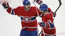 Montreal Canadiens' Andrei Markov (79) celebrates his goal with teammate Max Paci