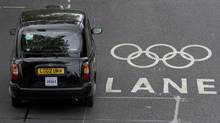A taxi drives along an Olympic traffic Lane in Westminster, London, July 20, 2012. (NEIL HALL/Reuters)