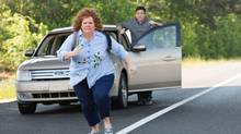 Jason Bateman, background, and Melissa McCarthy in a scene from Identity Thief. (AP)