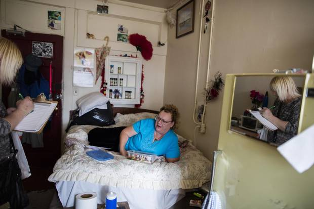 Cindy Bell, left, speaks with Dianne Cooper during her weekly rounds at the Astoria Hotel.