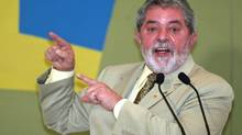 Brazil's President Luiz Inacio Lula da Silva speaks during a ceremony in Brasilia August 25, 2005. (JAMIL BITTAR/REUTERS)
