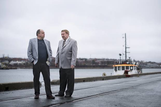 Brothers Brian left, and Frank Fogarty stand along the Halifax Harbour.