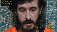 In this undated file image from a video posted on Islamic militant websites and made available June 9, 2010, a man identified as French security agent Denis Allex pleads for his release from the Somali militant group al-Shabaab. (AP)