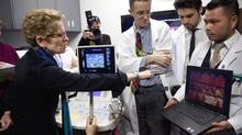 Ontario Premier Kathleen Wynne gets a demonstration of ultrasound equipment at the opening of the Louise Temerty Breast Cancer Centre on Thursday. (Moe Doiron/The Globe and Mail)