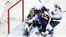 Colorado Avalanche left wing Jamie McGinn (11) scores a goal against Minnesota Wild goalie Ilya Bryzgalov during the third period of Game 1 of the first round of the 2014 Stanley Cup Playoffs at Pepsi Center. (Chris Humphreys/USA Today Sports)