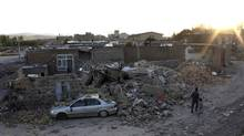 Ruins of a houses are seen after an earthquake in the city of Varzaqan in northwestern Iran, on Saturday, Aug. 11, 2012. A 6.2-magnitude earthquake hit the towns of Ahar, Haris and Varzaqan in East Azerbaijan province in northwestern Iran on Saturday, state TV said. Iran is located on seismic fault lines and is prone to earthquakes. It experiences at least one earthquake every day on average, although the vast majority are so small they go unnoticed. (Hamed Nazari/AP)
