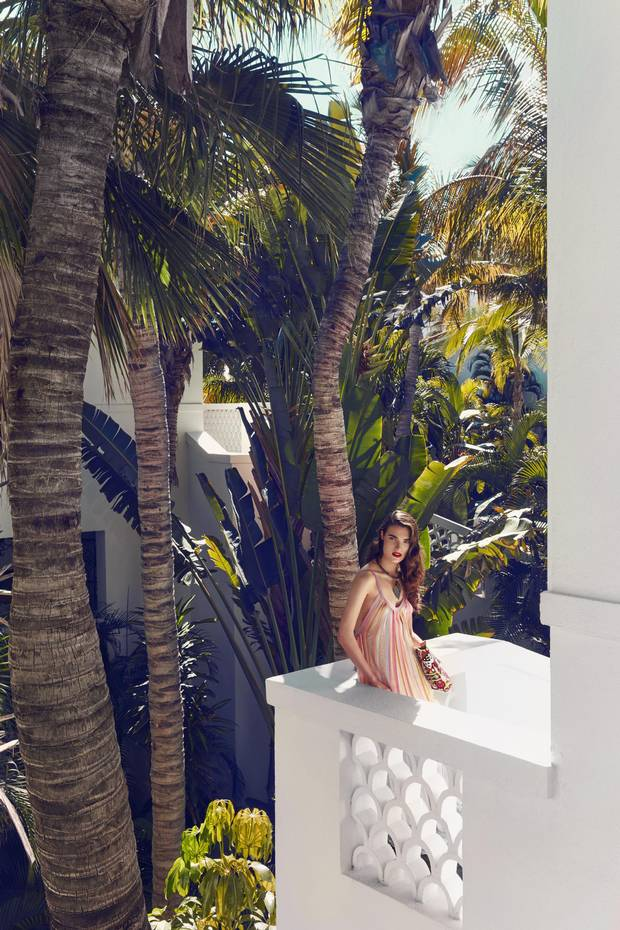 The bulk of the resort's rooms and suites are located in villas that snake around the coast, affording every accommodation a coveted ocean view. Missoni dress, $1,928 (U.S.), Jade Tribe bag, $490 (U.S.) at Neo One & Only Palmilla. Vintage Judith Hendler necklace, $1,500, earrings, $500 through www.caroletanenbaum.com.