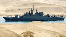 An Iranian naval ship travels through the Suez Canal near Ismailia, some 120 kilometres north of Cairo, in this 2011 file photo. Infrastructure projects announced by the government Monday include a new tunnel under the Suez Canal. (STRINGER/EGYPT/REUTERS)