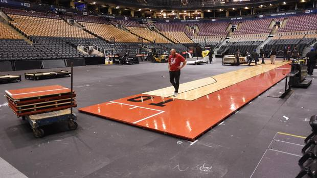 Up all night how stadium workers transformed the air for Built in basketball court