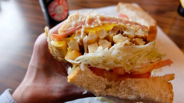 Pittsburgh's signature sandwich is the best-seller at Primanti Bros. and features sliced meat, french fries and coleslaw on sliced Italian bread