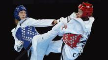 Canada's Karine Sergerie gets kicked in the face as she fights Franka Anic of Slovenia in the women's 67kg taekwondo quater-finals during the 2012 Summer Olympics in London on Friday, August 10, 2012. Canada lost the fight. (Sean Kilpatrick/THE CANADIAN PRESS)