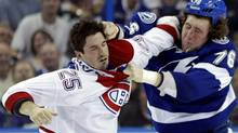 Montreal Canadiens' Brad Staubitz (25) and Tampa Bay Lightning's Pierre-Cedric Labrie (76) fight during the third period of an NHL hockey game on Tuesday Feb. 28, 2012, in Tampa, Fla. The Lightning won the game 2-1. (Chris O'Meara/AP)