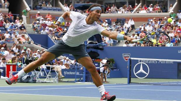 Rafael Nadal of Spain lunges for a serve from Ivan Dodig of Croatia at the U.S. Open tennis championships in New York August 31, 2013. Nadal won 6-4 6-3 6-3. (GARY HERSHORN/REUTERS)