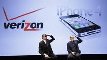 Dan Mead, left, CEO of Verizon Wireless, and Tim Cook, then-COO of Apple, announce that Verizon Wireless will carry Apple's iPhone, Tuesday, Jan. 11, 2011 in New York. (Mark Lennihan/AP)