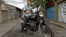 Actor Craig Olejnik and his 2010 Triumph Scrambler. (Fernando Morales/The Globe and Mail)