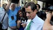 News crews try to get comments from Anthony Weiner as he leaves his Park Avenue apartment, Wednesday, July 31, 2013, in New York. (Louis Lanzano/AP)