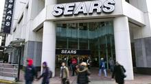 People walk past the main Sears store in downtown Vancouver, British Columbia on February 23, 2011. (Andy Clark/ Reuters/Andy Clark/ Reuters)