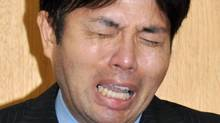 In this July 1, 2014 file photo, Hyogo Prefectural assemblyman Ryutaro Nonomura cries during a press conference in Kobe, western Japan. Nonomura, who was seen sobbing over dubious spending in a video that went viral, resigned Friday, July 11, 2014. (Kyodo News/AP)
