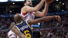 Toronto Raptors forward Linas Kleiza (11) drives to the hoop past Utah Jazz guard Jamaal Tinsley during first half NBA action in Toronto on Monday, November 12, 2012. (Frank Gunn/THE CANADIAN PRESS)