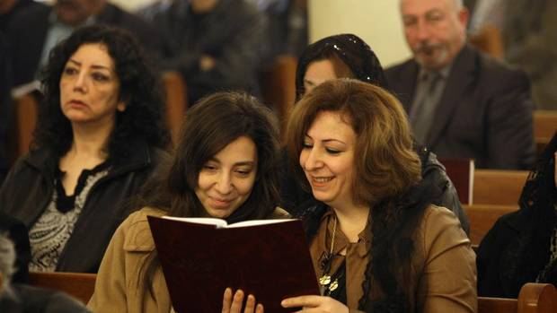 Iraqi Christians attend a Christmas mass at Virgin Mary Chaldean Church in Baghdad, Iraq, Tuesday, Dec. 25, 2012. Iraqi Christians gathered for Christmas services amid tight security. The exact number of Christians remaining in Iraq is not known, but it has fallen sharply from as many as 1.4 million before the U.S.-led invasion nearly a decade ago. Community leaders believe there are about 400,000 to 600,000 Christians left in the country, according to figures from the U.S. State Department. (Khalid Mohammed/AP)