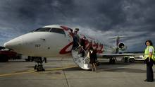 Passengers disembark Jazz flight in this file photograph. (JOHN LEHMANN/JOHN LEHMANN/GLOBE AND MAIL)