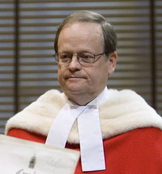 Justice Thomas Cromwell is sworn in by deputy registrat Louise Meagher during a public ceremony at the Supreme Court of Canada in Ottawa, Monday Feb. 16, 2009.