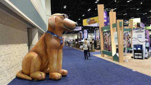 An inflatable dog from Adams on the exhibition floor at the Global Pet Expo in the Orange County Convention Center in Orlando, Fla., March 12, 2014. Americans spent $55.72 billion on their pets last year, according to the American Pet Products Association, and at this year's event, dog products dominated the Pet Expo. (TODD ANDERSON/NYT)