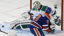 Dallas Stars goaltender Kari Lethonen (32) makes a save on Edmonton Oilers forward Ryan Nugent-Hopkins (93) during the first period at Rexall Place. (Perry Nelson/USA Today Sports)