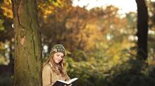 Young woman reading a book in park (Ljupco/Getty Images/iStockphoto)