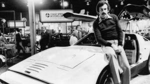 Malcolm Bricklin poses with his gull-winged sports car, the Bricklin SV1, during the Toronto International Auto Show in 1975 at the Toronto International Auto Show