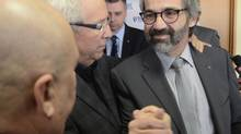 Former Bloc Québécois leader Daniel Paillé, right, is pictured after annoucing his resignation on Dec. 16, 2013. The party will choose its next leader in May, 2014. (Ryan Remiorz/The Canadian Press)