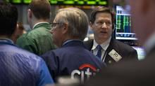Traders work on the floor of the New York Stock Exchange March 24, 2014. (BRENDAN MCDERMID/REUTERS)
