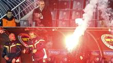 A flare falls during the Europa League soccer match between BATE Borisov and Fenerbahce at Sukru Saracoglu stadium in Istanbul February 21, 2013. (Reuters)
