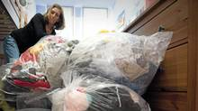 Marsha Lederman sorts through bags of clean clothing July 21, 2010 at her home in Vancouver after having a bedbug infestation. (John Lehmann/The Globe and Mail/John Lehmann/The Globe and Mail)