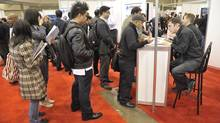 People line up for booths at a job fair in Toronto earlier this year. Manpower's quarterly survey shows the weakest hiring plans are in education and manufacturing of non-durable goods. (J.P. MOCZULSKI For The Globe and Mail)