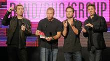 Chad Kroeger, Mike Kroeger, Ryan Peake and Daniel Adair of Nickelback present an award at the 2011 American Music Awards in Los Angeles on Sunday, Nov. 20, 2011. (Kevork Djansezian/Getty Images)