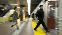 Commuters board a TTC subway at Kennedy Station in Scarborough, Ontario Wednesday, September 25, 2013. Police are investigating another armed robbery, this time at Chester station, the evening of Oct. 6. (Kevin Van Paassen/The Globe and Mail)