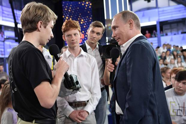 Russian President Vladimir Putin arrives for the TV show 'A Grown-up Conversation with Vladimir Putin' at the Sirius educational centre for gifted children in Sochi on July 21, 2017.